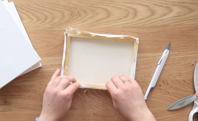 remove the canvas fabric from the wooden frames