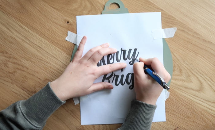 use a pen to trace an outline of all the letters