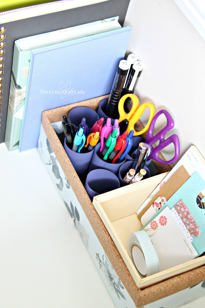 Upcycled cardboard box filled with stationery supplies