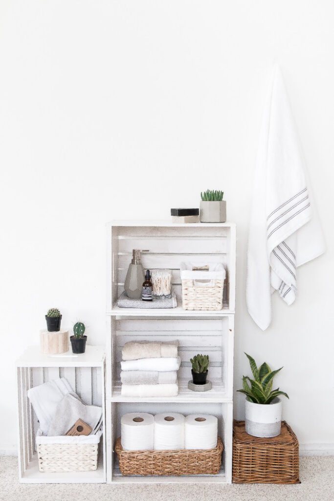White wooden shelves in a bathroom.