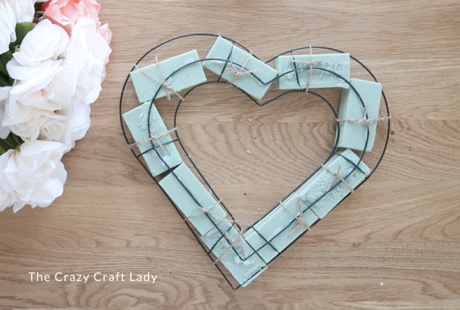 Continue adding foam all the way around the heart wreath
