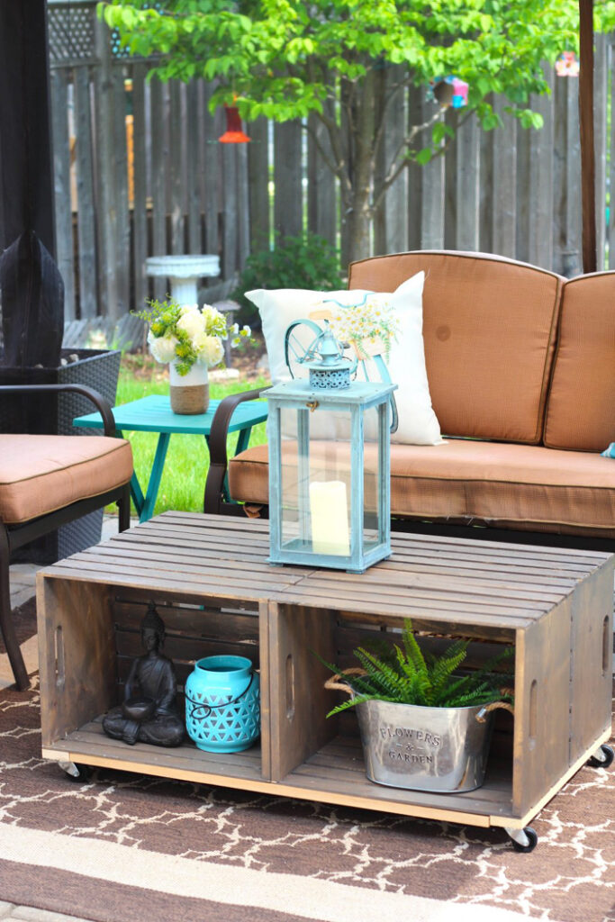 Wooden crate coffee table in an outdoor seating area.