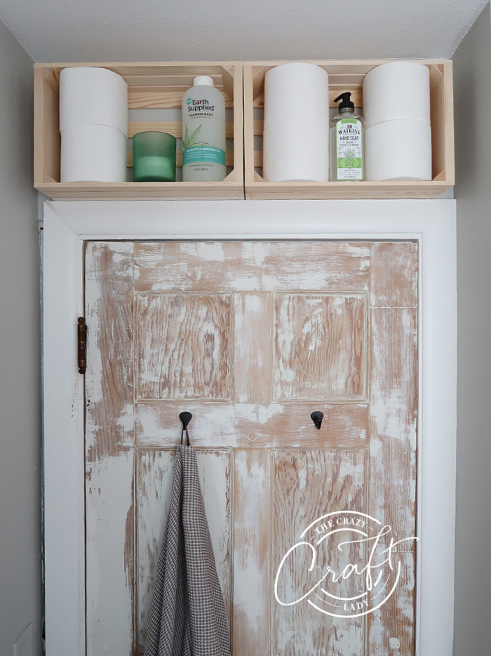 DIY wood crate bathroom shelves