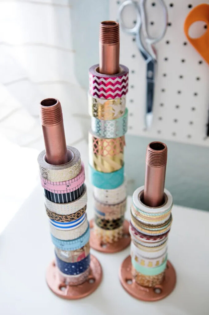 Washi tape stored on a copper pipe