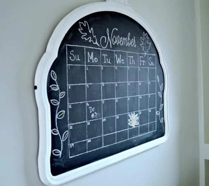 A large frame with a chalkboard organizer inside.