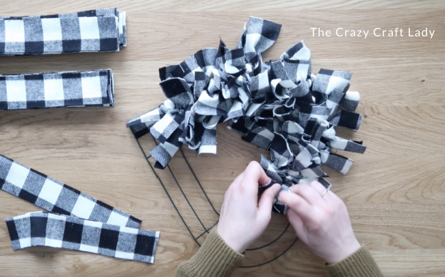 Tie fabric until the wreath is evenly filled out and no wire shows through