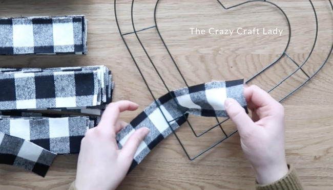 Tie one fabric strip around the inner and middle wire