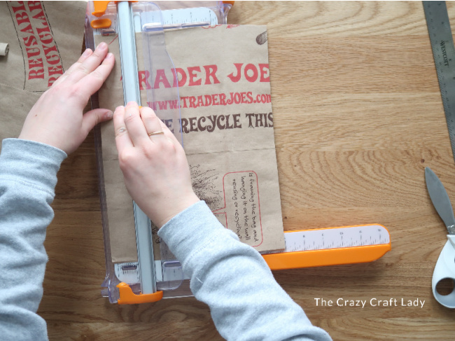 Use a paper cutter to cut the paper bag pieces down to size