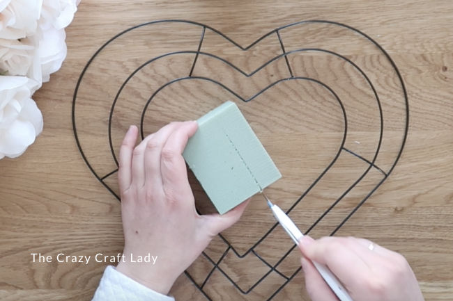 Use a pen blade to carefully score and snap the foam down to size