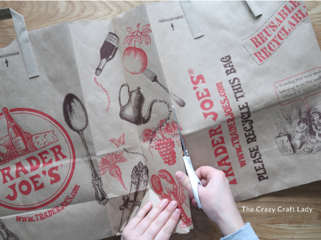 Use scissors to disassemble the bag, cutting around the folds