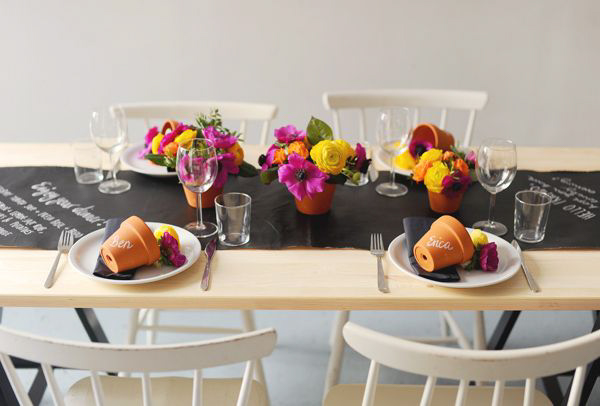 A table set with a chalkboard table runner.