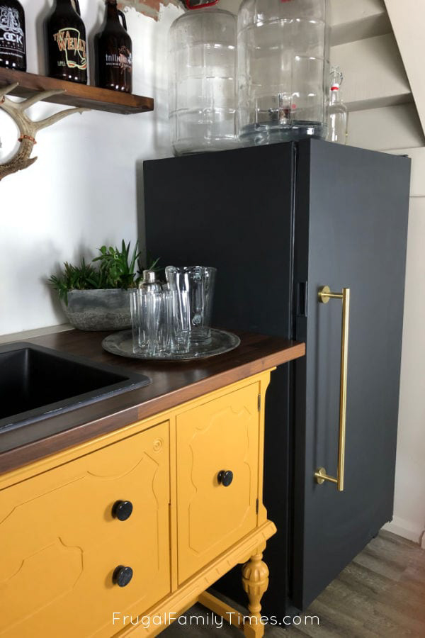 A black chalkboard fridge in a kitchen.