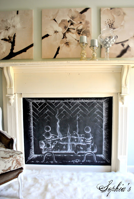 A mantelpiece with a chalk drawing of a fire inside.