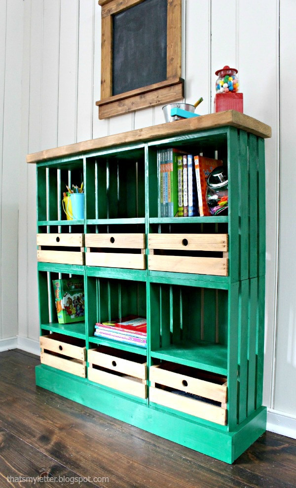 Wooden storage unit with wooden drawers made from crates.