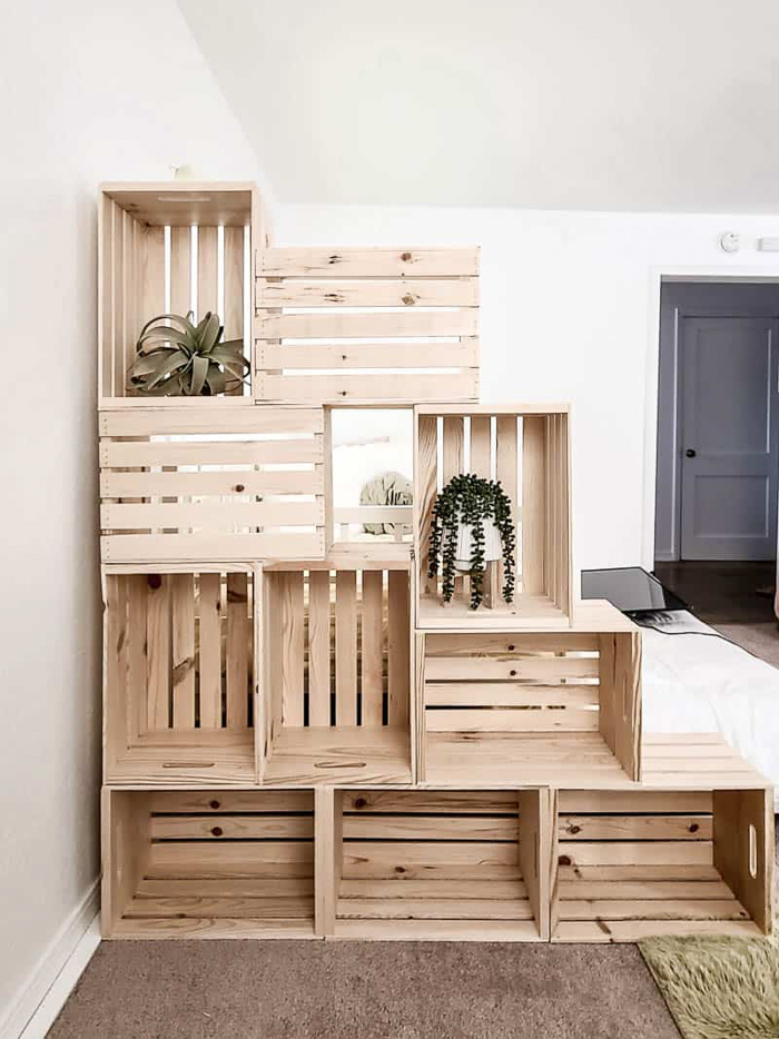A large freestanding bookshelf made from wooden crates.