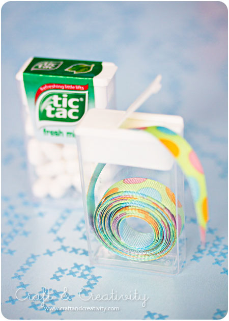 Rolls of ribbon stored in Tic Tac boxes.