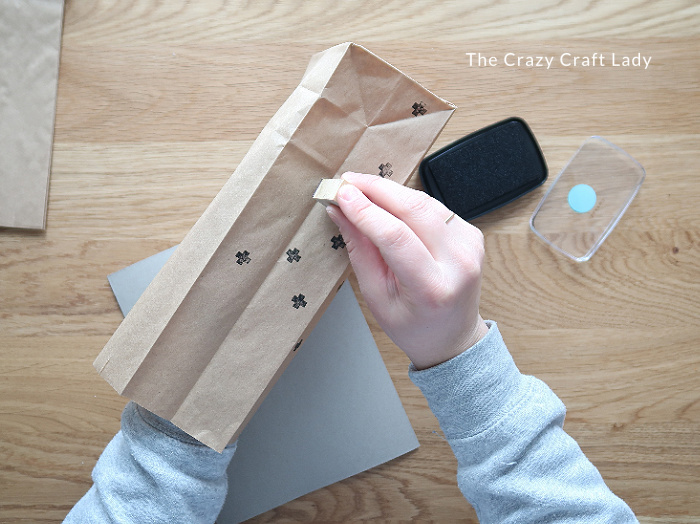 use a small rubber stamp and ink to decorate the bag
