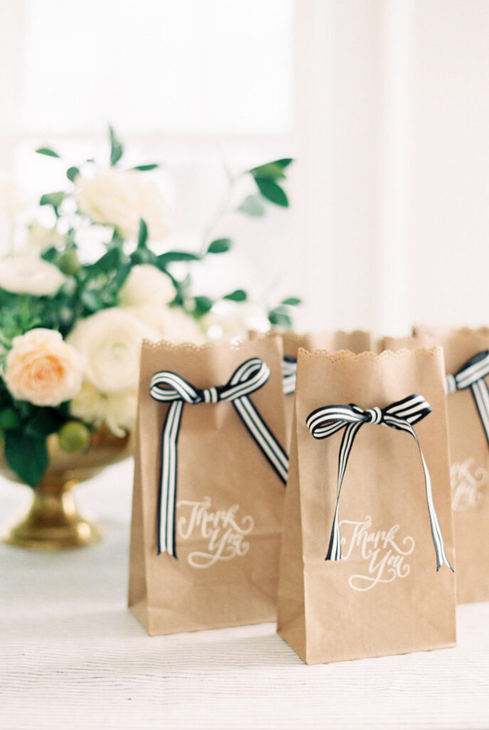 Paper bags tied with ribbon.