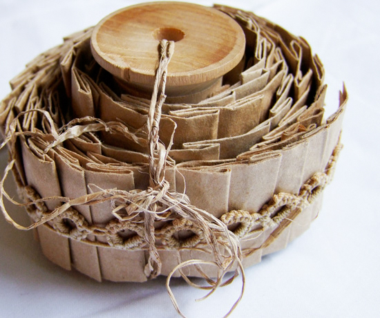 Pleated paper bag ribbon wrapped around a wooden reel.