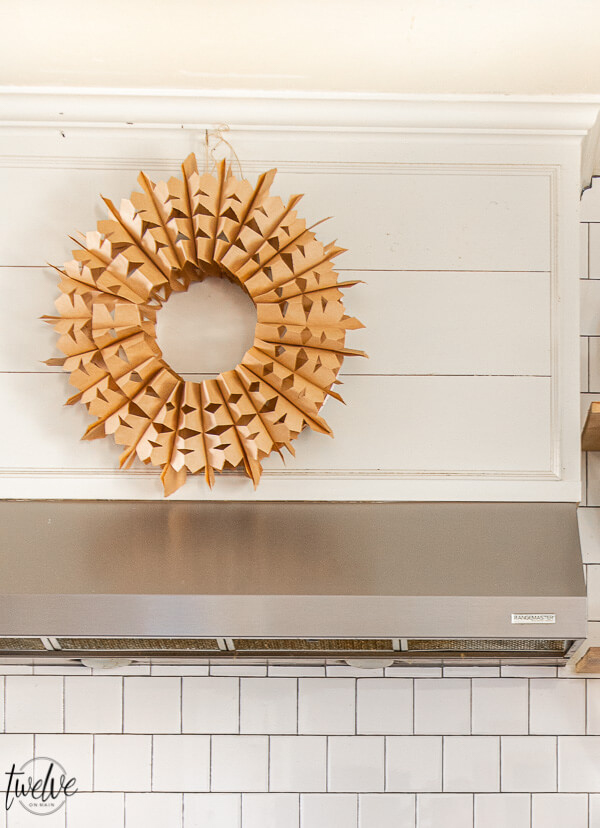 A paper bag wreath hanging above a stove.