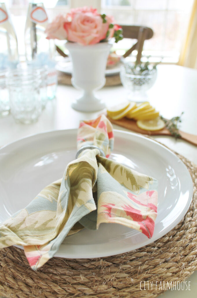 A floral napkin on a plate.