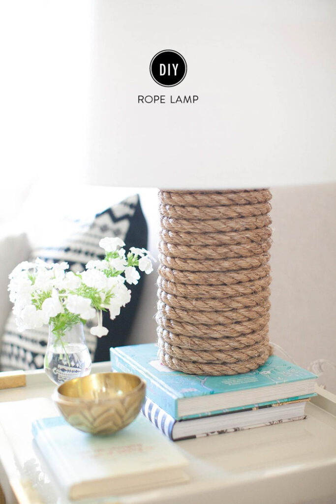 A lamp with a rope-wrapped base and a white shade.