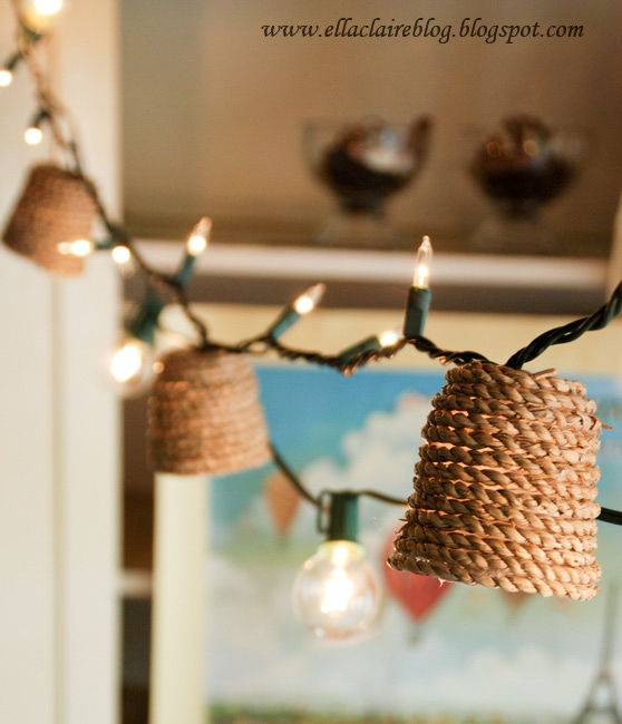 A string of fairy lights with rope-wrapped shades.