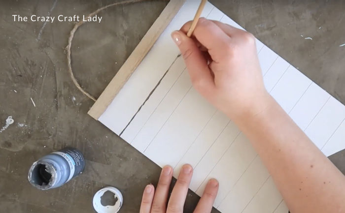 Paint over the lines lightly with a fine-point paint brush