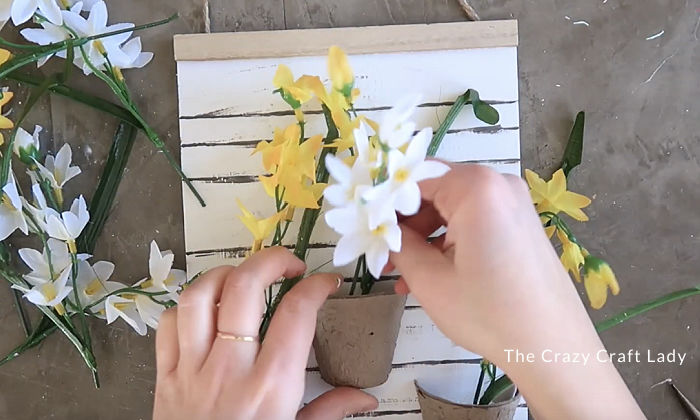 Stuff silk flowers into the paper pots