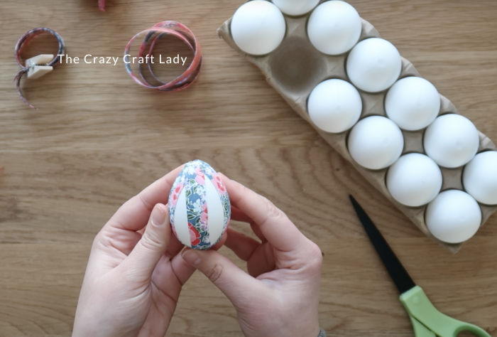leave a gap between pieces of fabric tape on the egg
