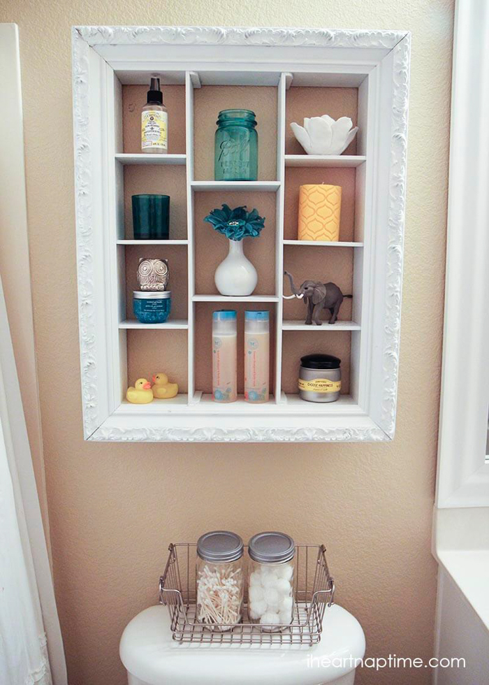 White shelving unit in a bathroom.