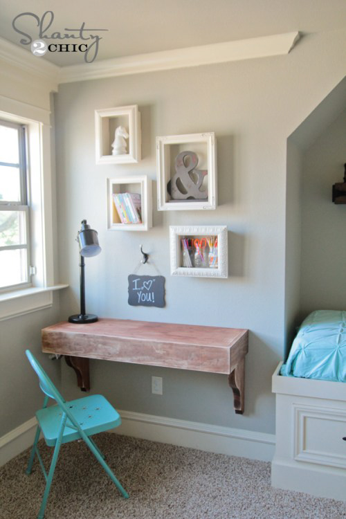 Picture frame shelving above a desk.