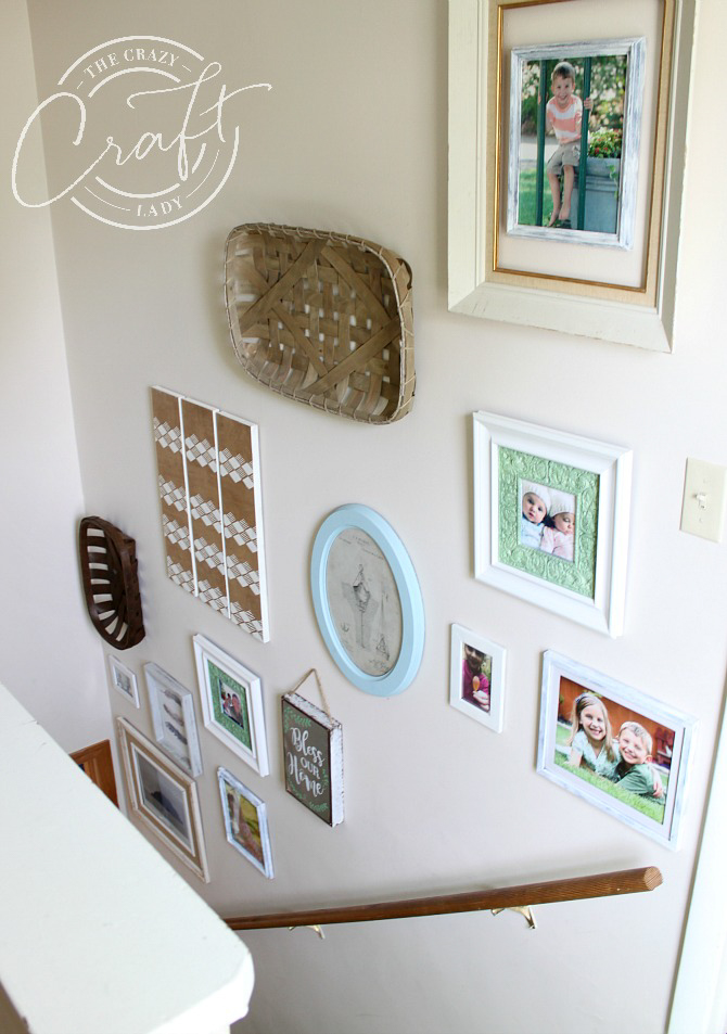 A mismatched gallery wall on a staircase - upcycle picture frames