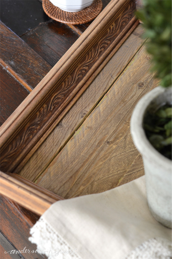 A wooden tray with a carved border.
