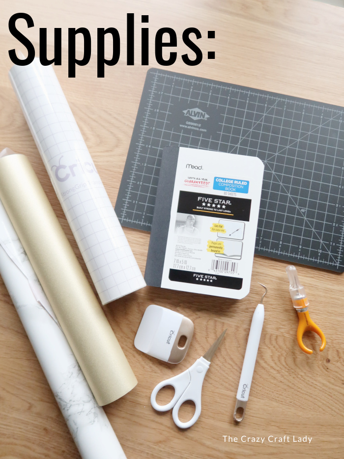 Supplies to make a marble notebook cover with gold vinyl detail