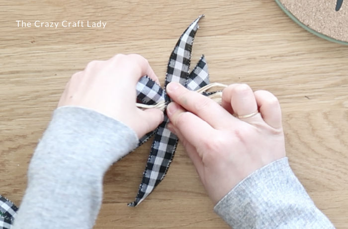 Tie the ribbon and raffia together in the center with more ribbon
