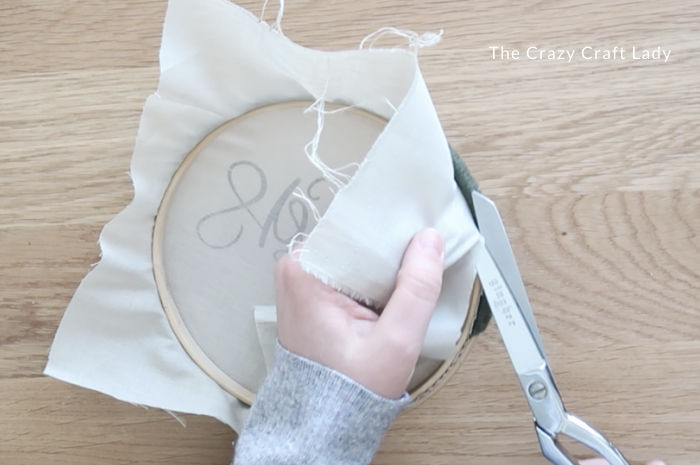 add the fabric to the embroidery hoop and trim away excess