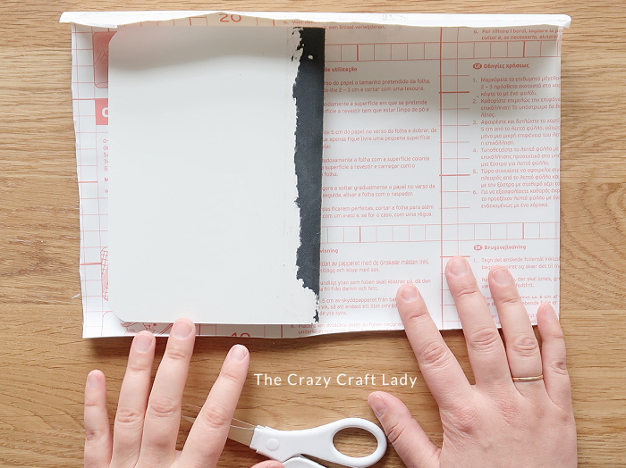 cut the contact paper about one inch larger than the notebook