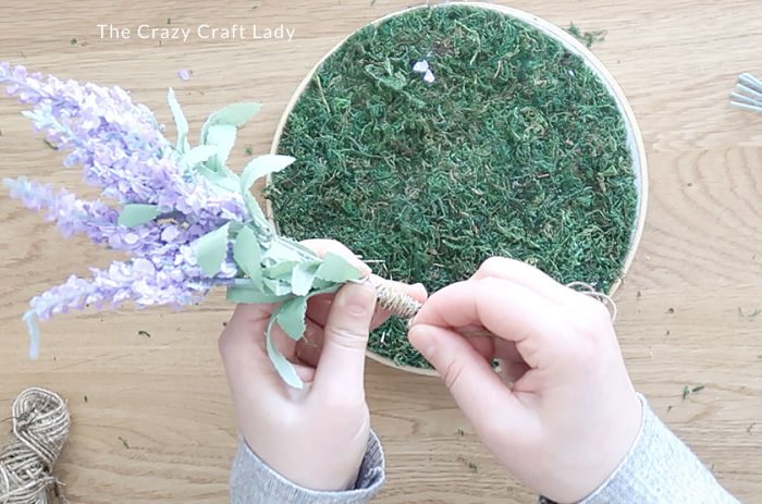 tie the flowers together with twine wrapped around the stem base