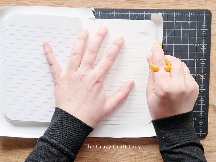 trim away excess contact paper