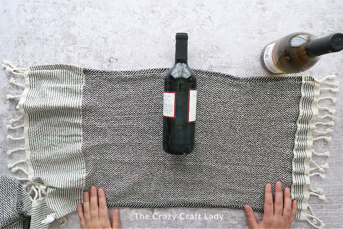 lay the bottle in the middle of the towel