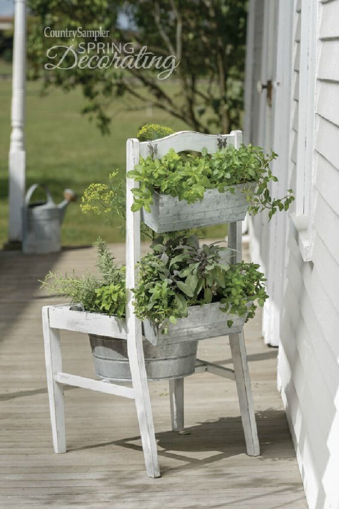Repurposed Garden Projects - old chair planter with galvanized buckets