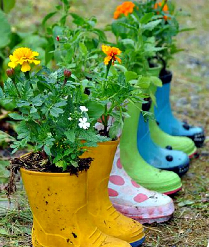 Upcycled Garden Projects  - planted rain boots in the garden