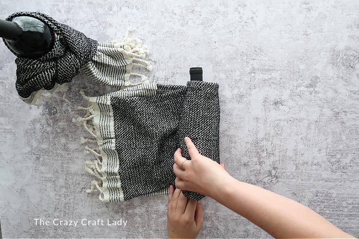 tighten the towel around the bottle - dish towel wine wrap