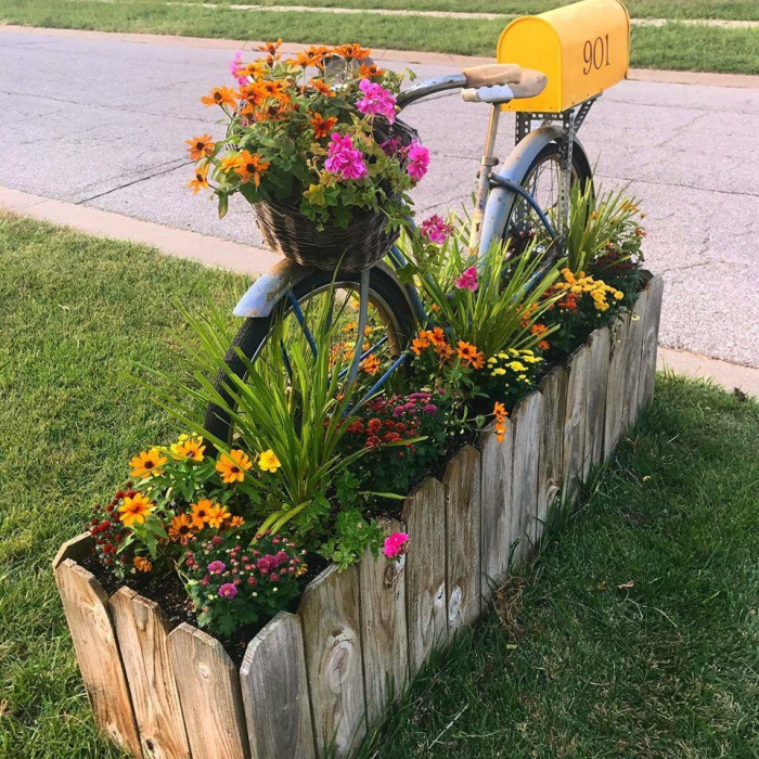upcycled bicycle mailbox with flower bed