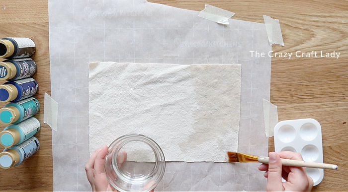 use a paint brush to wet the fabric