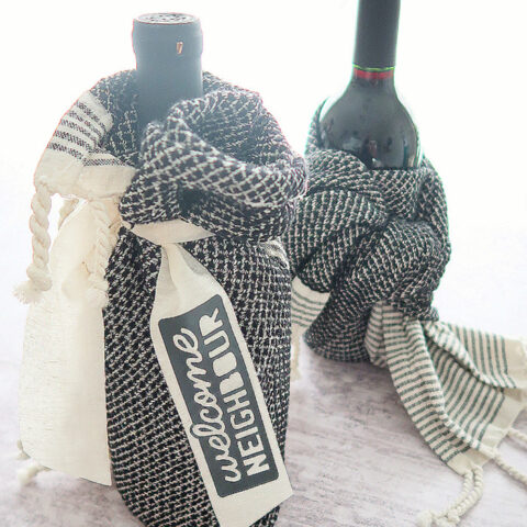 wine bottle and tea towel hostess gift and a customized ribbon