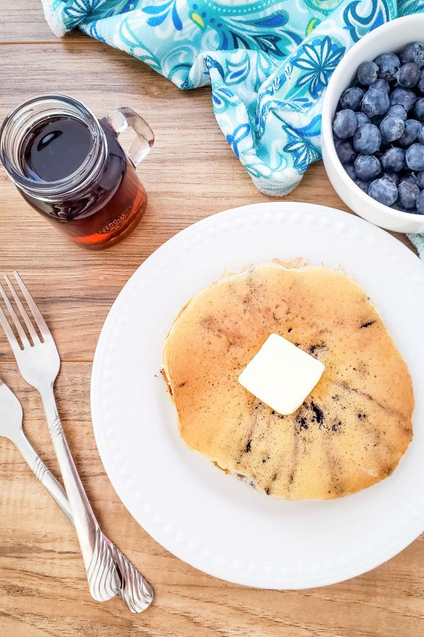 Plate of muffin mix pancakes with homemade brown sugar syrup.