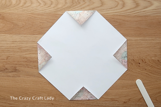 Fold each corner flap in and secure with a piece of tape