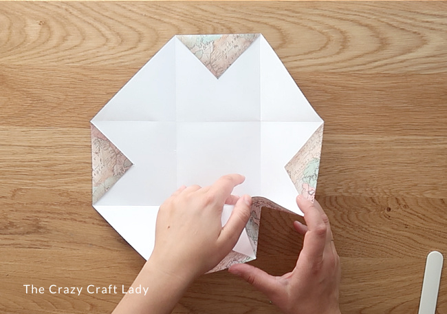 Fold up the long edges to form the cube seams